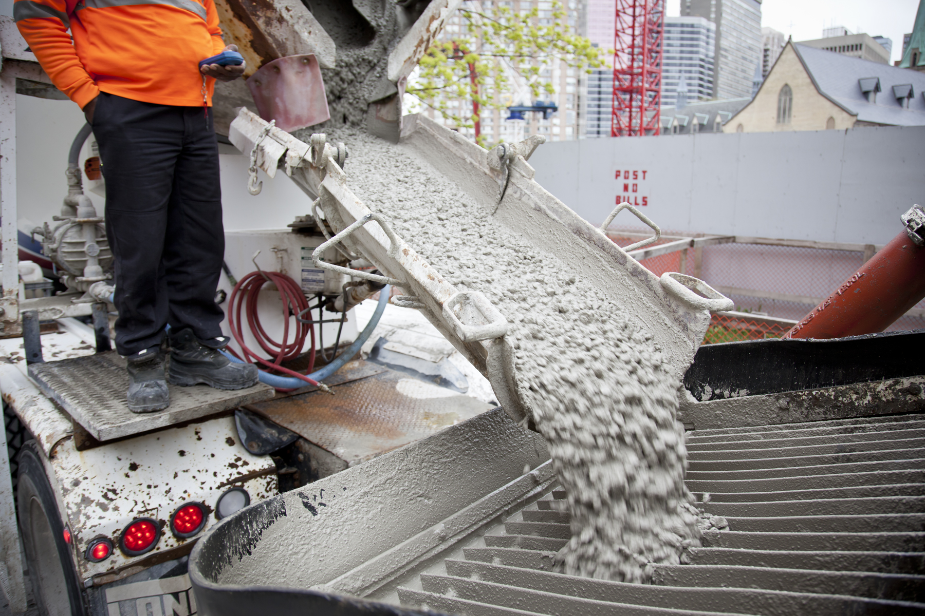 Concrete pouring out of the mixer for a job