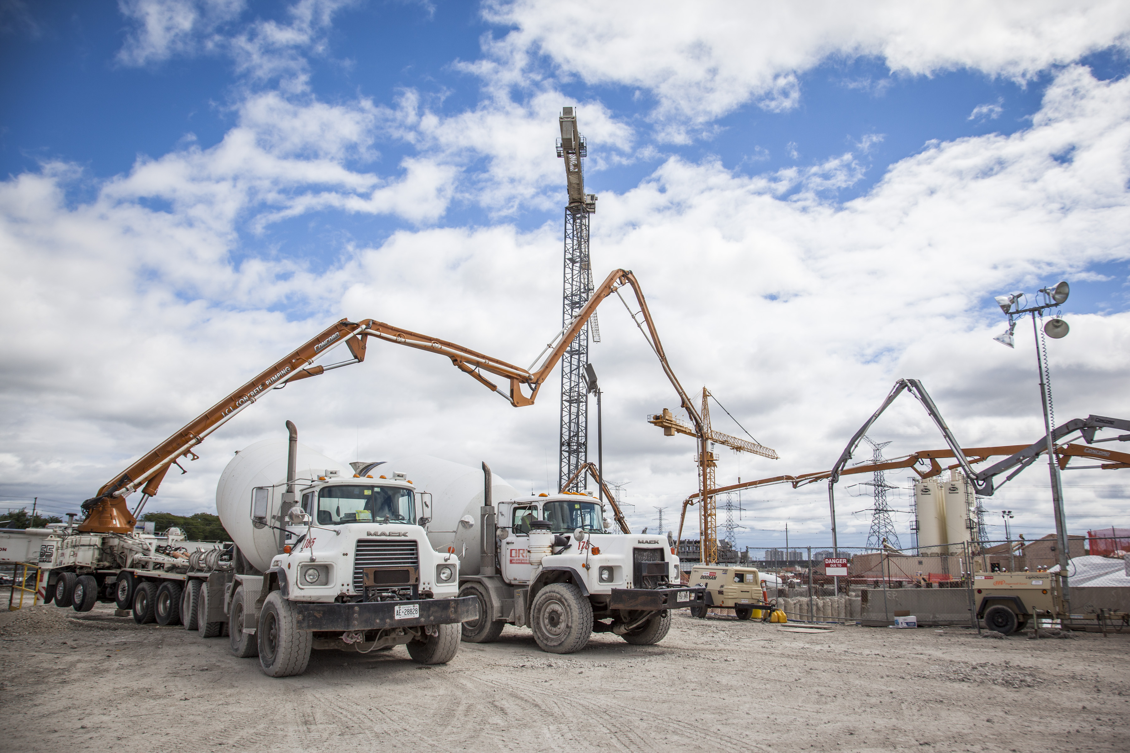 Trucks at a pour on a sunny day